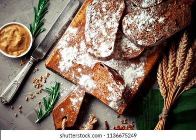 Bread and pastries in a composition with kitchen accessories on an old background