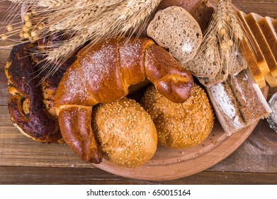 Bread and pastries on a wooden background