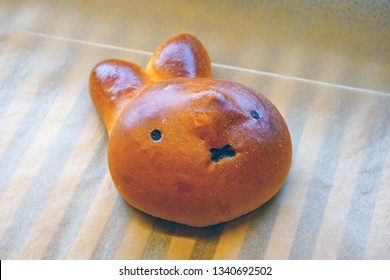 Bread pastries shaped as the Miffy bunny rabbit cartoon character in a Japanese bakery
