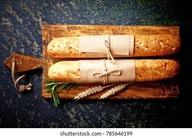 Bread pastry on an old background in a composition with kitchen accessories view from the top