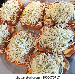 A bread pizza made with a lot of cheese made at home.