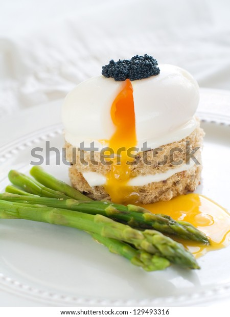 Bread with poached egg with asparagus, selective focus