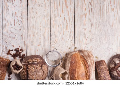 Bread products are on the edges of the table