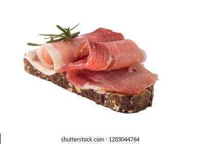 Bread with prosciutto isolated on white background