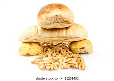 Bread pyramid and hazelnuts on white background