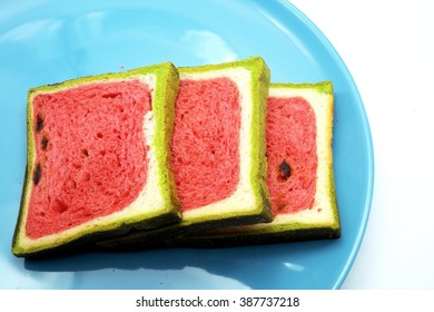 Bread with red-green color or watermelon style on blue plate.