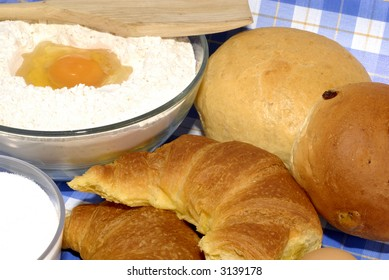 bread rolls and  ingredients for preparing, flour, sugar, eggs. Nutrition, food, sweets concept.