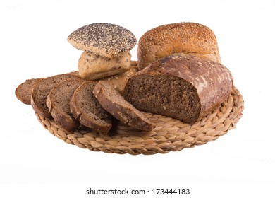 Bread and rolls on wicker rug isolated on a white background.