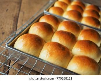 bread rolls on wood table.