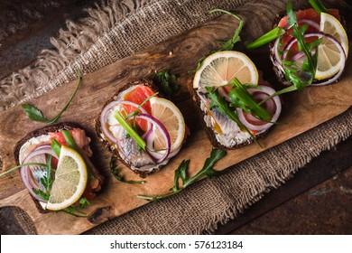 Bread, salmon, herring, onion and lemon diagonal horizontal