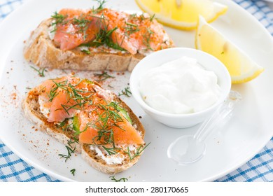 bread with salted salmon and cream cheese for breakfast, close-up, top view, horizontal