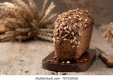 bread with seeds on old wooden background in a rustic style