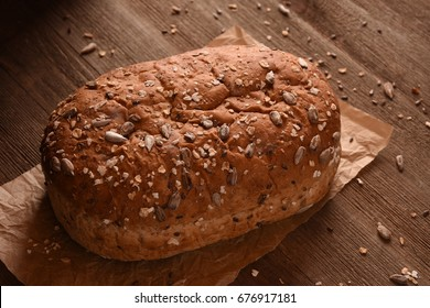Bread with Seeds on a Wooden table