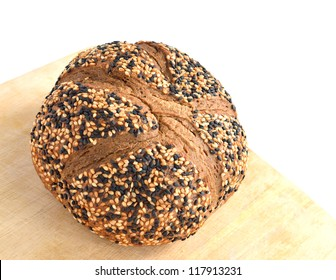 Bread with sesame on wood background