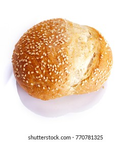 Bread with sesame seeds on white background