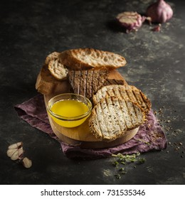 bread set with butter. Photo in a dark key