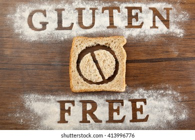 Bread slice with Gluten Free text on wooden background