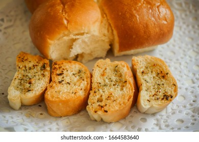 Bread sliced on a plate, a piece of wheat bread,