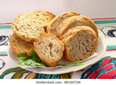 bread sliced on a white plate