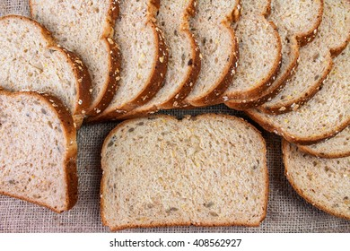 Bread Slices on Sack Background.