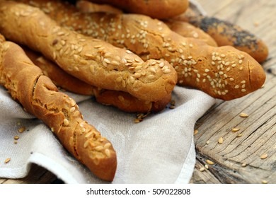 Bread sticks with flax seed.Bread sticks with sesame seeds.Bread sticks with poppy seeds.