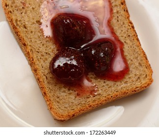 Bread with strawberry jam on a white plate, Valentine's Day breakfast