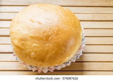 Bread Stuffed  buns on wood table.