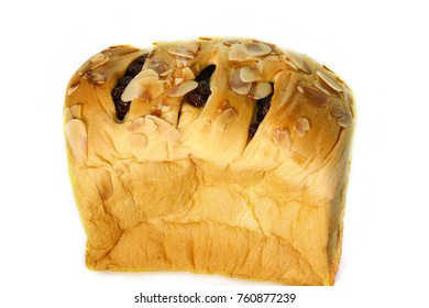 Bread stuffed with raisins and Almond slices on a white background.