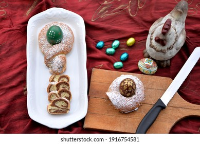 Bread texture of Easter bread slices of home baked babka stuffed with walnuts and sprinkled with sugar powder - sweet bread braided with Easter egg and Easter hen and eggs in background