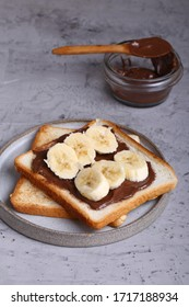bread toast with chocolate paste and banana for breakfast