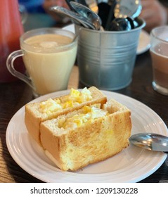 Bread toast with mayonnaise egg as filling, served with Malaysia's Horlicks drink for breakfast.