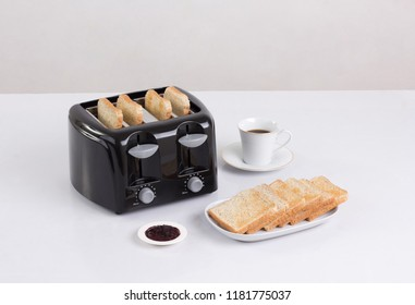 Bread toaster and bread isolated on white background