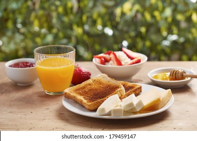 Bread toasts for breakfast in outdoor table