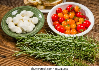 Bread tomatoes and cheese ingredients for luch with rosemary