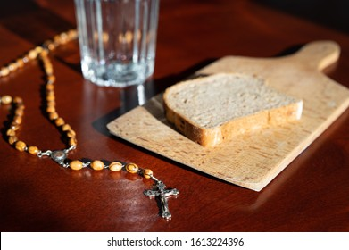 bread and water lent before easter with rosary beads .