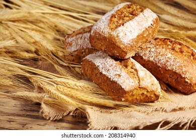 bread and wheat on the wooden