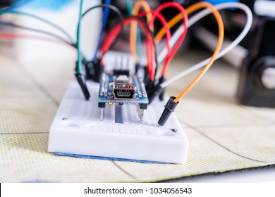 Breadboard connected to Arduino. Electronic board in hardware repair shop