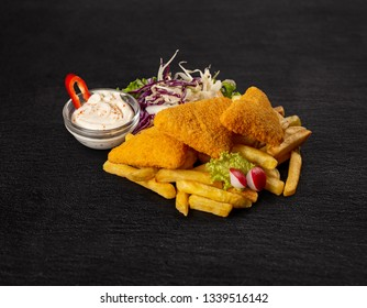Breaded cheese with french fries and garlic sauce on black slate table