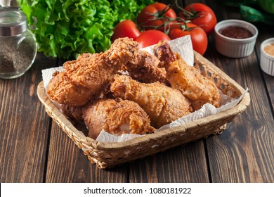 Breaded crispy fried kentucky chicken drumctick in the basket
