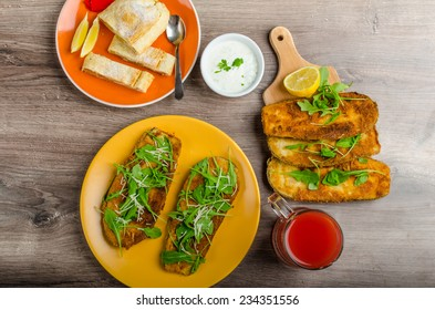 Breaded eggplant parmesan and arugula, fresh limonade from red orange and cheese dip