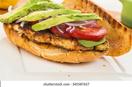 Breaded and fried boneless chicken breast on crispy roll topped with avocado and tomato.  Seasoned with spicy Louisiana Remoulade Sauce.