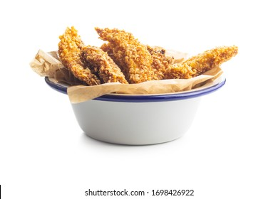Breaded fried chicken strips in bowl isolated on white background.Tasty fast food.