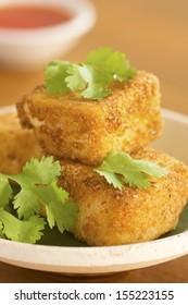 Breaded Fried Silken Tofu w Chili Oil in Background Non sharpen