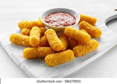 Breaded mozzarella cheese sticks with tomato basil sauce