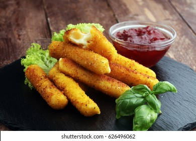 Breaded mozzarella cheese sticks with tomato ketchup