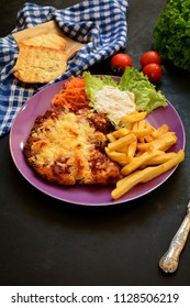 Breaded Veal Steak with French Fries with Fresh Vegetables