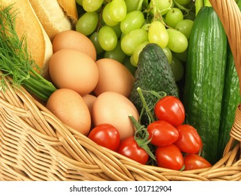 Bread,eggs and cucumbers in a wicker basket