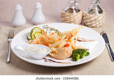 breading shrimps with caviar on wooden table