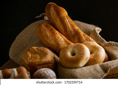 Breads,baguettes and bagels on burlap sack. Delicious breads image.