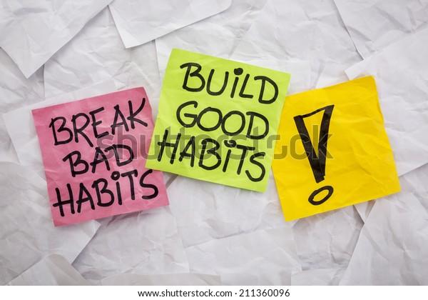 break bad habits, build good habits - motivational reminder on colorful sticky notes - self-development concept